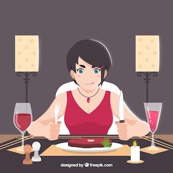 Moderne frau isst ein steak