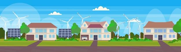 Moderne freundliche häuser mit windkraftanlage und solarpanel öko-immobilienhütten alternatives energiekonzept landschaftshintergrund horizontales banner