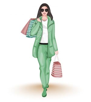 Moderne junge frau, die einkaufstaschen in gehender haltung hält.