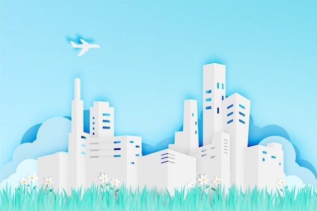 Moderne stadt in der papierkunstart mit blumenfeld-vektorillustration