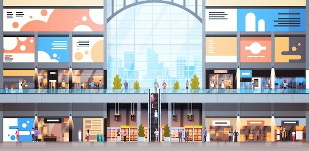 Moderner einkaufszentrum-innenraum mit großem einzelhandelsgeschäft vieler leute
