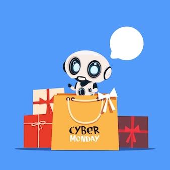 Moderner roboter, der einkaufstasche mit cyber montag-text online hält