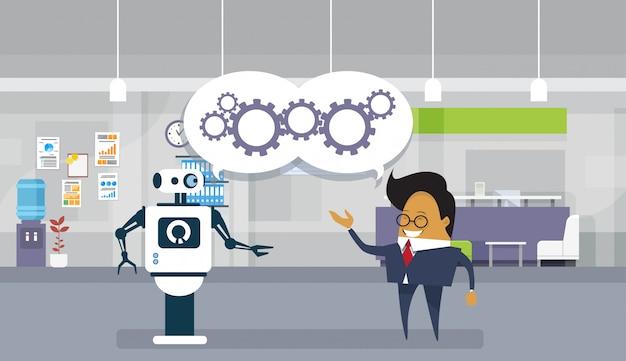 Moderner roboter und geschäftsmann, die zusammen teamwork und zusammenarbeits-konzept gedanklich lösen