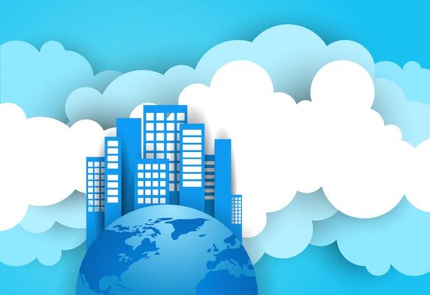 Modernes wolkenkratzer-gebäude auf erdplaneten-form über hintergrund des blauen himmels und der wolken