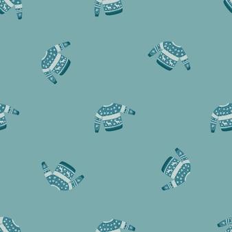 Modisches nahtloses gekritzelmuster mit kuscheligem pulloverdruck. winterkonzept