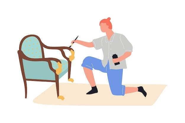 Möbelrenovierungsprozess. mann, der den stuhl malt