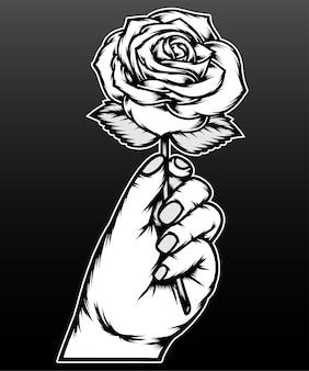 Monochrome hand, die rose lokalisiert auf schwarz hält