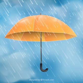 Monsunjahreszeithintergrund mit orange regenschirm