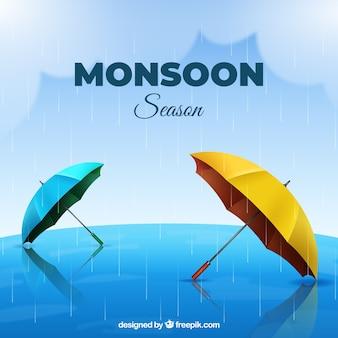 Monsunjahreszeithintergrund mit realistischen regenschirmen