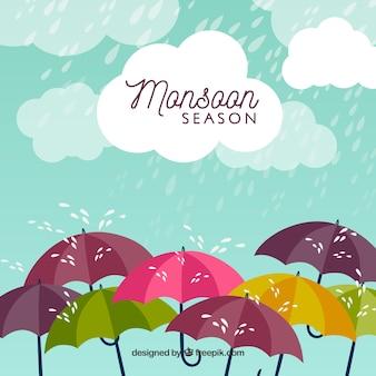 Monsunjahreszeithintergrund mit regen und regenschirmen