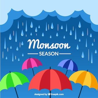 Monsunjahreszeithintergrund mit regenschirmen