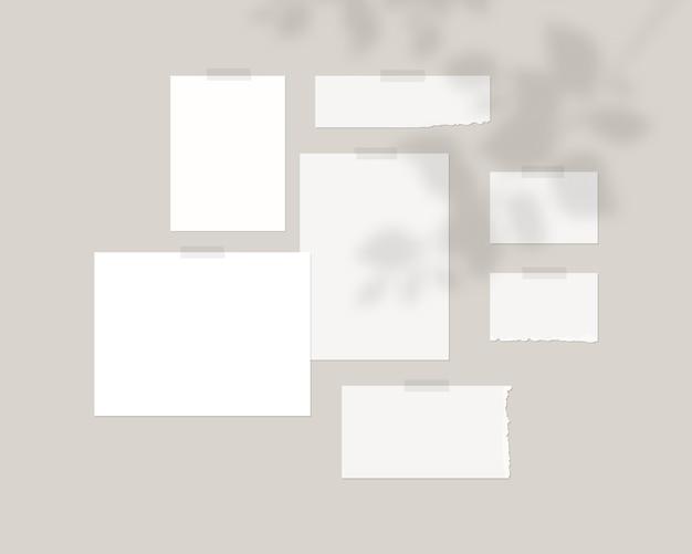 Moodboard-vorlage leere blätter aus weißem papier an der wand mit schattenauflage