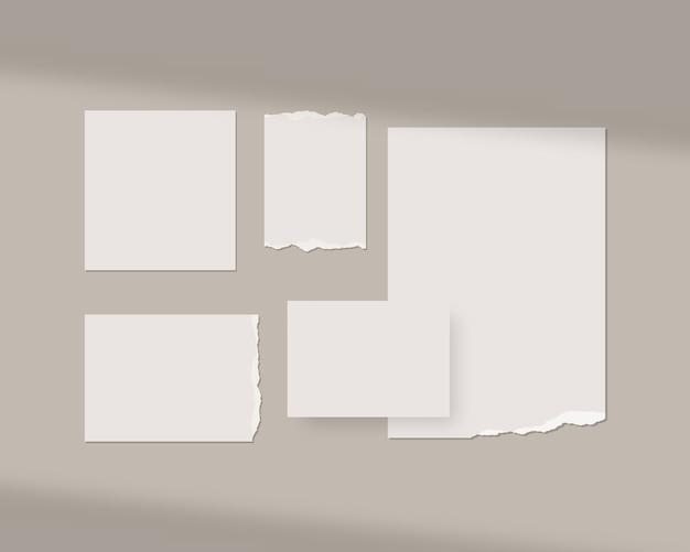 Moodboard-vorlage. leere weiße blätter an der wand mit schattenauflage. isoliert. vorlagenentwurf. realistisch