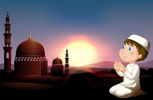 Moslemischer mann, der an der moschee betet