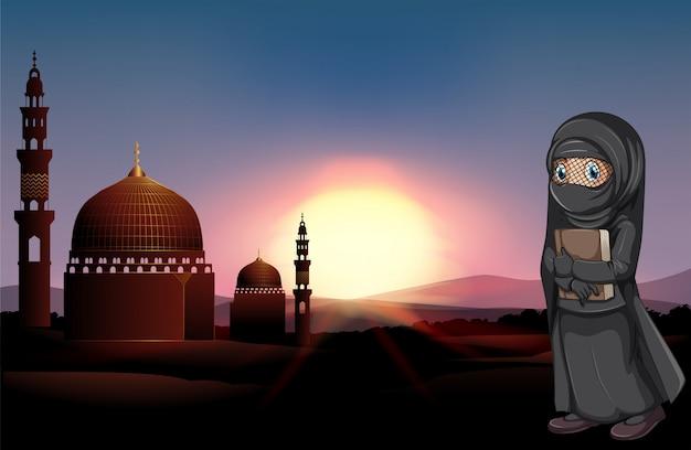 Moslemisches mädchen, das buch an der moschee hält