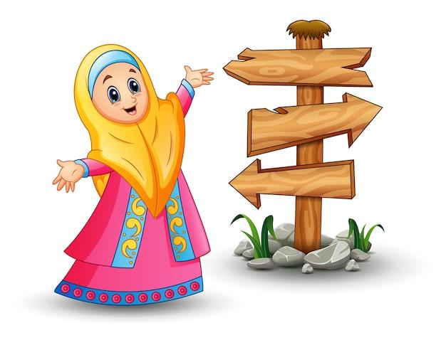 Moslemisches mädchen, das gelben schleier trägt