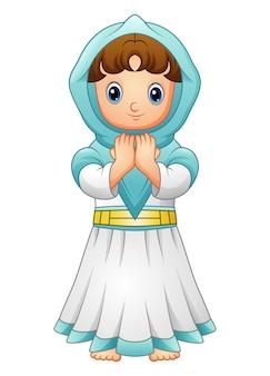 Moslemisches mädchen, das mit dem tragen des blauen schleiers lokalisiert auf weißem hintergrund betet