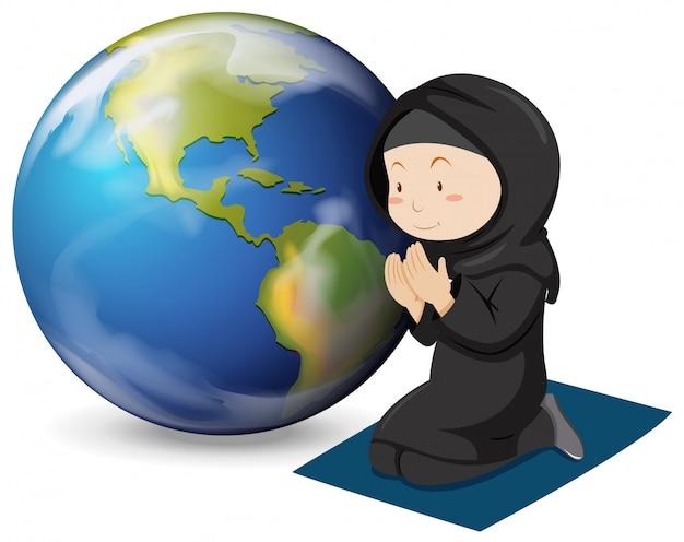 Moslemisches mädchen im schwarzen kostüm betend