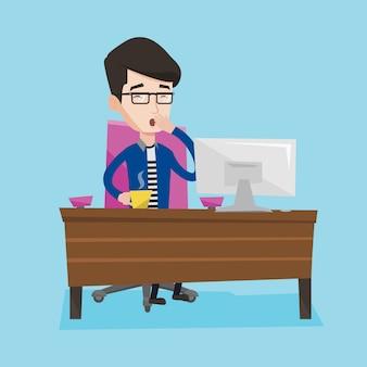 Müder angestellter, der im büro arbeitet.