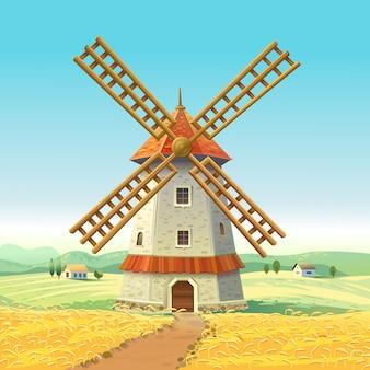 Mühle auf einem sonnigen feld. holzmühle. weizenfeld