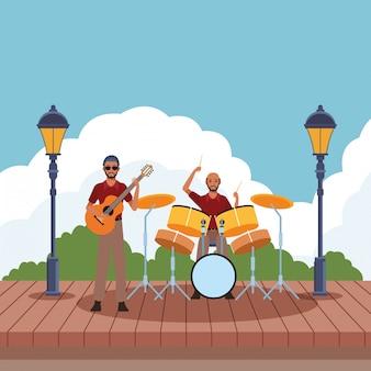 Musiker spielt schlagzeug und gitarre