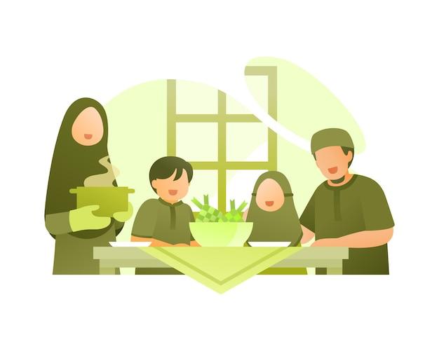 Muslimische familie essen zusammen, um eid al fitr zu feiern