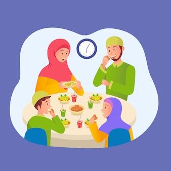 Muslimische familie isst iftar nach dem fasten im ramadan. familientreffen beim abendessen im ramadan