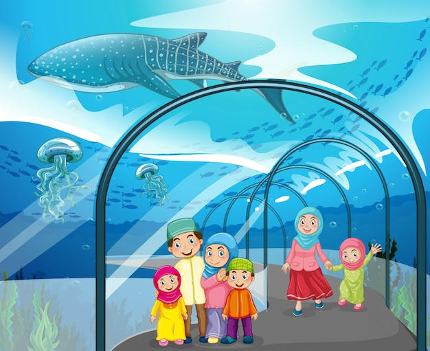 Muslimische menschen besuchen das aquarium
