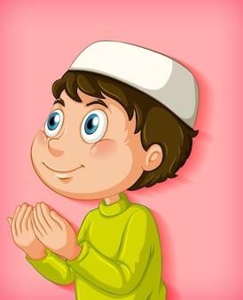 Muslimischer junge, der auf farbverlaufshintergrund betet