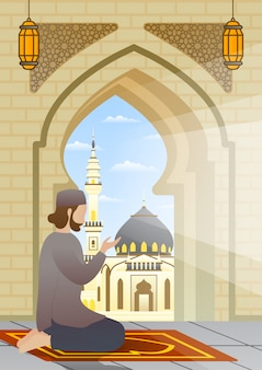 Muslimischer mann, der auf teppich in der moscheeterrasse kniet und betet.