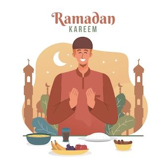Muslimischer mann, der betet, bevor er iftar hat