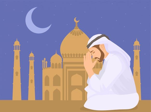 Muslimischer mann, der betet und moscheehintergrund