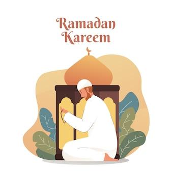Muslimischer mann, der betet, während rosenkranzperlen halten