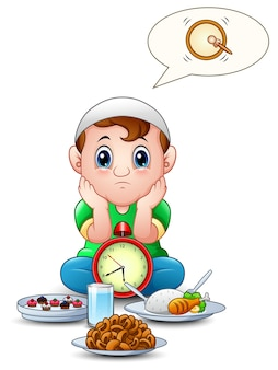 Muslimisches kind sitzen auf dem boden während der wartezeit brechen fasten