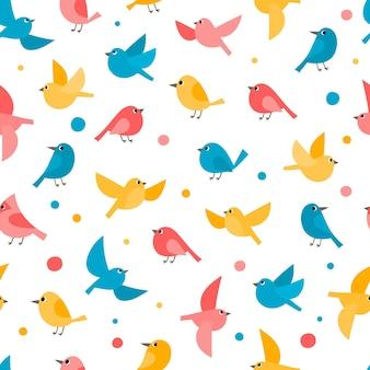 Muster mit bunten fliegenden vögeln isoliert auf weiss. vektorfrühlingsnahtloses muster kann für tapeten, musterfüllungen, webseitenhintergrund, oberflächenbeschaffenheiten verwendet werden.