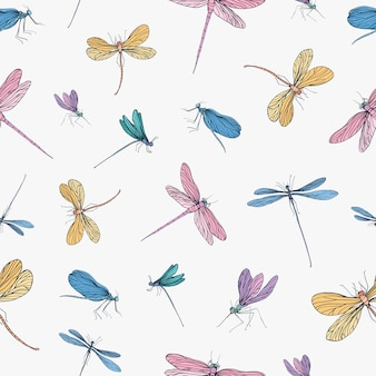 Muster mit handgezeichneten libellen auf weißem hintergrund.