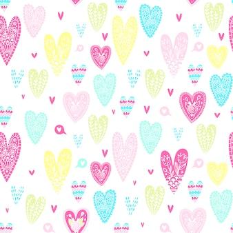 Muster von herzen in der gekritzelart. zum valentinstag. helles und buntes muster