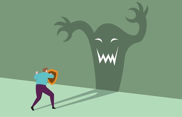 Mut geschäftsmann mit schild bereit zuversichtlich gegenüber monster
