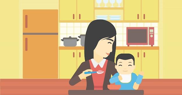 Mutter füttert baby.