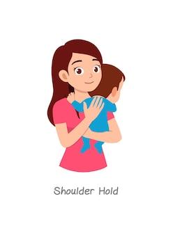Mutter hält baby mit pose namens shoulder hold