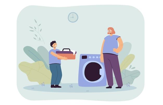 Mutter und sohn beim wäschewaschen