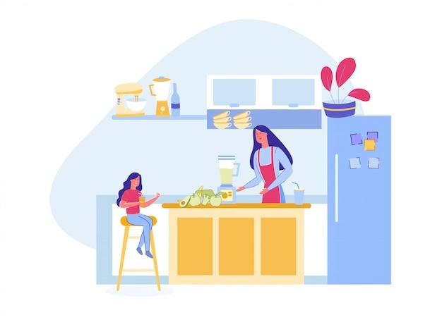 Mutter und tochter bereiten vegetarischen smoothie zu.