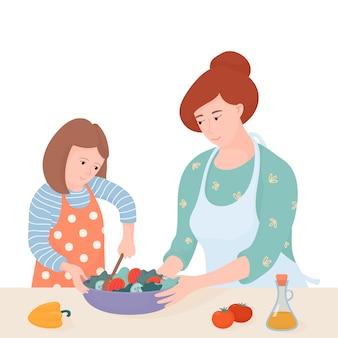 Mutter und tochter kochen zusammen in der küche, mutter hilft ihrem kind, einen salat zu machen