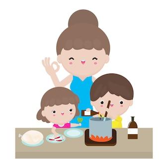 Mutter und tochter und sohn bereiten gemeinsam zu hause gesundes essen zu