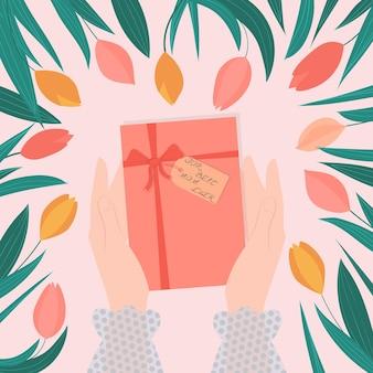 Muttertagsgrußkarte für die beste mutter aller zeiten geschenkbox in händen und tulpen