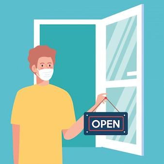 Nach der quarantäne wieder geöffnet, mann mit etikett der wiedereröffnung des geschäfts und offener tür, wir sind wieder geöffnet