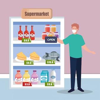 Nach der quarantäne wieder geöffnet, mann mit etikett der wiedereröffnung des geschäfts, wir sind wieder geöffnet, supermarkt kaufen lebensmittel