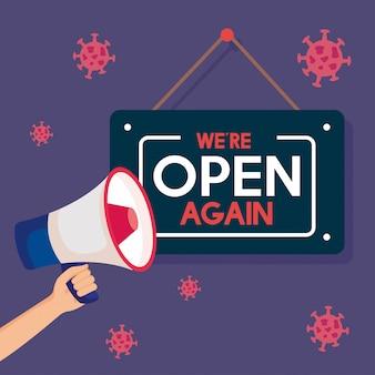 Nach der quarantäne wieder geöffnet, wiedereröffnung des geschäfts, wir sind wieder geöffnet schriftzug mit megaphon