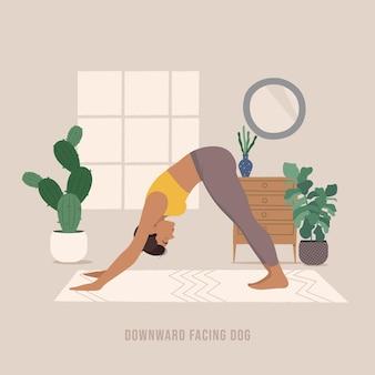 Nach unten gerichtete hundepose junge frau, die yoga-pose praktiziert