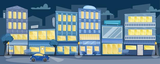 Nachtstadtlandschaft. straße mit hellen häusern, schildern, bäumen und bänken, ein auto auf der straße.